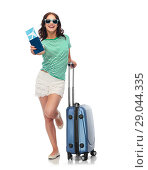 Купить «teenage girl with travel bag and air ticket», фото № 29044335, снято 30 июня 2018 г. (c) Syda Productions / Фотобанк Лори