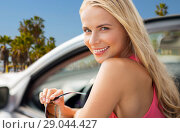 Купить «happy young woman in convertible car», фото № 29044427, снято 17 августа 2017 г. (c) Syda Productions / Фотобанк Лори