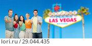 Купить «happy friends showing thumbs up at las vegas sign», фото № 29044435, снято 30 июня 2018 г. (c) Syda Productions / Фотобанк Лори