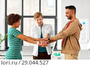 Купить «happy creative team stacking hands at office», фото № 29044527, снято 11 марта 2018 г. (c) Syda Productions / Фотобанк Лори