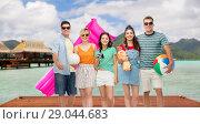 Купить «happy friends with beach accessories on bora bora», фото № 29044683, снято 30 июня 2018 г. (c) Syda Productions / Фотобанк Лори