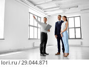 Купить «realtor showing new office room to customers», фото № 29044871, снято 8 июня 2018 г. (c) Syda Productions / Фотобанк Лори