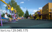 Купить «Defocused summer children playground with kids and parents. HD 1080 fast motion», видеоролик № 29045175, снято 23 февраля 2019 г. (c) Dmitry Domashenko / Фотобанк Лори