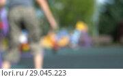 Купить «Very unfocused summer children playground with kids and parents. HD fast motion», видеоролик № 29045223, снято 23 февраля 2019 г. (c) Dmitry Domashenko / Фотобанк Лори