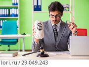 Купить «Young handsome lawyer working in the office», фото № 29049243, снято 22 мая 2018 г. (c) Elnur / Фотобанк Лори