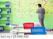 Купить «Businessman with many conflicting priorities», фото № 29049343, снято 23 мая 2018 г. (c) Elnur / Фотобанк Лори
