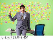 Купить «Businessman with many conflicting priorities», фото № 29049451, снято 24 мая 2018 г. (c) Elnur / Фотобанк Лори