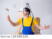 Купить «Painter contractor working with virtual reality goggles», фото № 29049635, снято 23 мая 2017 г. (c) Elnur / Фотобанк Лори