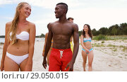 Купить «mixed race couple walking along beach with friends», видеоролик № 29050015, снято 24 августа 2018 г. (c) Syda Productions / Фотобанк Лори