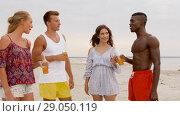 Купить «friends with non alcoholic drinks on beach», видеоролик № 29050119, снято 24 августа 2018 г. (c) Syda Productions / Фотобанк Лори