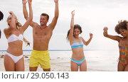 Купить «happy friends dancing at summer beach party», видеоролик № 29050143, снято 24 августа 2018 г. (c) Syda Productions / Фотобанк Лори