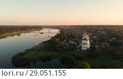 Купить «Flight of the camera over the ancient Orthodox Church. The Church of the Trinity, Totma, Russia. Architectural forms reminiscent of a ship. View of the church in the rays of the red sunset», видеоролик № 29051155, снято 15 августа 2018 г. (c) Mikhail Starodubov / Фотобанк Лори