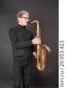 Купить «Portrait of a saxophonist», фото № 29053423, снято 28 октября 2012 г. (c) Argument / Фотобанк Лори