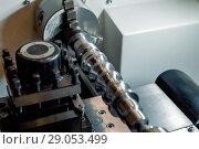 Купить «metal workpiece clamped in the lathe chuck CNC machine», фото № 29053499, снято 24 октября 2017 г. (c) Андрей Радченко / Фотобанк Лори