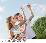 Купить «two friendly kids playing with simple paper planes», фото № 29053791, снято 8 апреля 2020 г. (c) Яков Филимонов / Фотобанк Лори