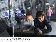 Купить «Children playing in bunker questroom», фото № 29053927, снято 21 октября 2017 г. (c) Яков Филимонов / Фотобанк Лори