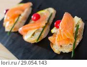 Купить «Canapes with salmon, butter and cranberries», фото № 29054143, снято 25 апреля 2019 г. (c) Яков Филимонов / Фотобанк Лори