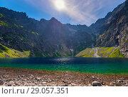 Купить «pure picturesque lake of Cherny Staw in high Tatras, Poland», фото № 29057351, снято 18 августа 2017 г. (c) Константин Лабунский / Фотобанк Лори