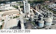 Купить «Aerial view of cement production plant», видеоролик № 29057999, снято 26 августа 2018 г. (c) Яков Филимонов / Фотобанк Лори