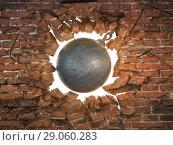 Купить «Wrecking ball destroying the brick wall», фото № 29060283, снято 19 марта 2019 г. (c) Maksym Yemelyanov / Фотобанк Лори