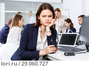 Купить «Portrait of unhappy girl in modern open plan office on background with coworkers», фото № 29060727, снято 21 апреля 2018 г. (c) Яков Филимонов / Фотобанк Лори