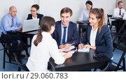 Купить «Colleagues discussing about business project in office», фото № 29060783, снято 28 октября 2016 г. (c) Яков Филимонов / Фотобанк Лори