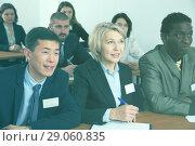 Купить «Group of employees listening to business training», фото № 29060835, снято 12 февраля 2018 г. (c) Яков Филимонов / Фотобанк Лори