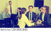 Купить «Smiling colleagues with laptops having a productive day», фото № 29060843, снято 28 октября 2016 г. (c) Яков Филимонов / Фотобанк Лори