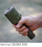 Купить «Antitank grenade in the male hand close-up», фото № 29061535, снято 19 августа 2018 г. (c) Олег Белов / Фотобанк Лори