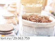Купить «Image of dark pecan in container», фото № 29063759, снято 4 сентября 2017 г. (c) Яков Филимонов / Фотобанк Лори