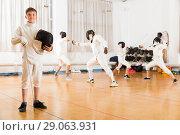 Купить «teen fencer posing with rapier», фото № 29063931, снято 30 мая 2018 г. (c) Яков Филимонов / Фотобанк Лори