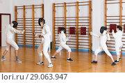Купить «Young fencers training with coach», фото № 29063947, снято 30 мая 2018 г. (c) Яков Филимонов / Фотобанк Лори