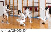Купить «Young fencers training with coach», фото № 29063951, снято 30 мая 2018 г. (c) Яков Филимонов / Фотобанк Лори