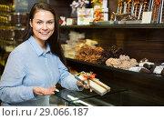 Купить «Girl selecting fine chocolates», фото № 29066187, снято 22 сентября 2018 г. (c) Яков Филимонов / Фотобанк Лори