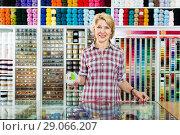 Купить «Mature glad woman customer picking various ribbon», фото № 29066207, снято 18 июля 2019 г. (c) Яков Филимонов / Фотобанк Лори