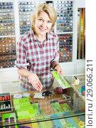 Купить «woman seller standing at counter with various scissors in sewing store», фото № 29066211, снято 19 января 2019 г. (c) Яков Филимонов / Фотобанк Лори