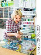 Купить «Mature woman near glass showcase in boutique», фото № 29066223, снято 22 октября 2019 г. (c) Яков Филимонов / Фотобанк Лори