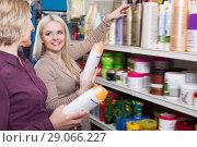 Купить «Two positive women chooses shampoo», фото № 29066227, снято 15 ноября 2018 г. (c) Яков Филимонов / Фотобанк Лори