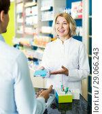 Купить «Helpful pharmacist serving and consulting man», фото № 29066243, снято 21 сентября 2018 г. (c) Яков Филимонов / Фотобанк Лори