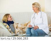 Купить «Mature doctor questioning young blonde with flu at home», фото № 29066283, снято 23 марта 2019 г. (c) Яков Филимонов / Фотобанк Лори