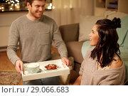 Купить «happy couple with food on tray at home», фото № 29066683, снято 13 января 2018 г. (c) Syda Productions / Фотобанк Лори