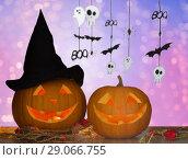 Купить «close up of halloween pumpkins on table», фото № 29066755, снято 17 сентября 2014 г. (c) Syda Productions / Фотобанк Лори