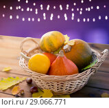 Купить «close up of pumpkins in basket on wooden table», фото № 29066771, снято 19 октября 2015 г. (c) Syda Productions / Фотобанк Лори