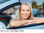 Купить «woman in convertible car over venice beach», фото № 29066783, снято 17 августа 2017 г. (c) Syda Productions / Фотобанк Лори