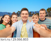 Купить «happy friends taking selfie over white background», фото № 29066803, снято 30 июня 2018 г. (c) Syda Productions / Фотобанк Лори