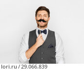 Купить «happy young man with fake moustache», фото № 29066839, снято 15 декабря 2017 г. (c) Syda Productions / Фотобанк Лори