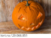 Купить «jack-o-lantern or carved halloween pumpkin», фото № 29066851, снято 18 сентября 2017 г. (c) Syda Productions / Фотобанк Лори