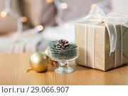 Купить «christmas fir decoration with cone, ball and gift», фото № 29066907, снято 15 ноября 2017 г. (c) Syda Productions / Фотобанк Лори