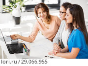 Купить «businesswomen with laptop working at office», фото № 29066955, снято 17 марта 2018 г. (c) Syda Productions / Фотобанк Лори