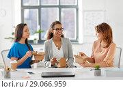 Купить «happy businesswomen eating take out food at office», фото № 29066959, снято 17 марта 2018 г. (c) Syda Productions / Фотобанк Лори